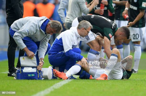 Thomas Morus Scholl team doctor Peter Franitza Franco Di Santo of FC Schalke 04 and Guido Burgstaller of FC Schalke 04 during the game between Hertha...