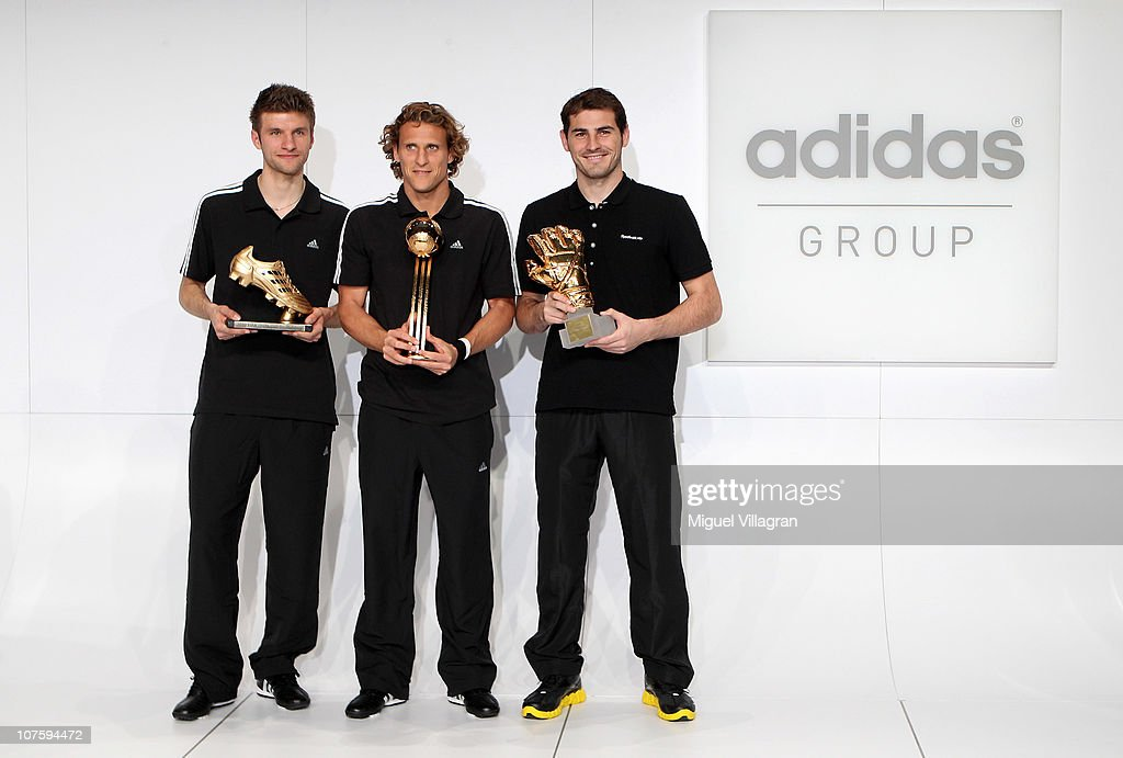 Thomas Mueller, adidas Golden Boot Winner, Diego Forlan, adidas Golden Ball Winner, and Iker Casillas, adidas Golden Glove Winner pose with their FIFA 2010 World Cup adidas Golden Awards during the award ceremony at the adidas headquarters on December 14, 2010 in Herzogenaurach, Germany.