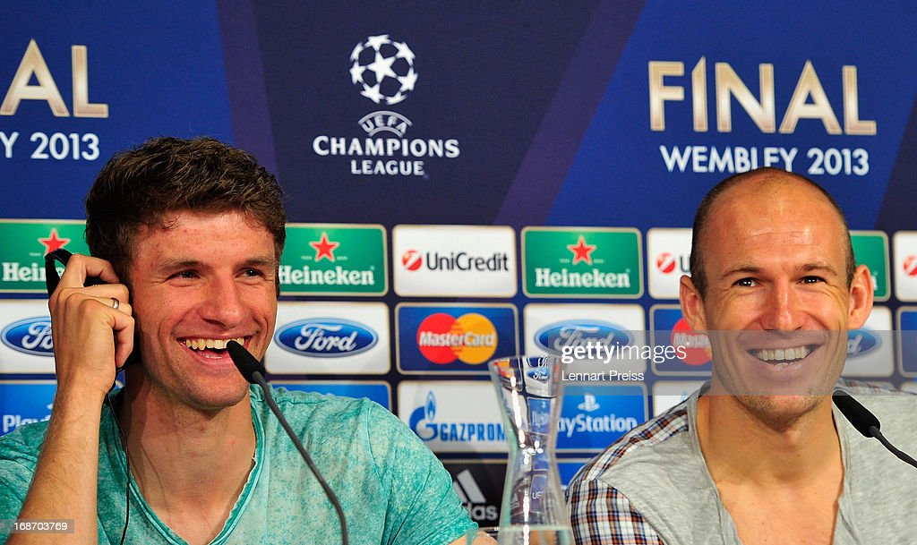 Thomas Mueller (L) and Arjen Robben of Muenchen speak during a press conference during the UEFA Champions League Finalist Media Day at Allianz Arena on May 14, 2013 in Munich, Germany.