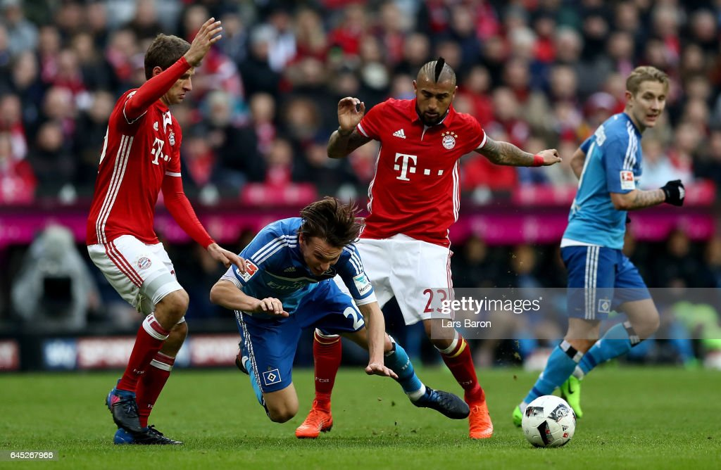 Thomas Mueller (L) and Arturo Vidal of Muenchen and Albin Ekdal of Hamburg battle for the ball during the Bundesliga match between Bayern Muenchen and Hamburger SV at Allianz Arena on February 25, 2017 in Munich, Germany.