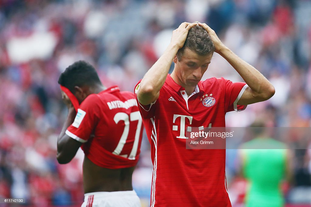 Thomas Mueller (front) and David Alaba of Muenchen react after the Bundesliga match between Bayern Muenchen and 1. FC Koeln at Allianz Arena on October 1, 2016 in Munich, Germany.