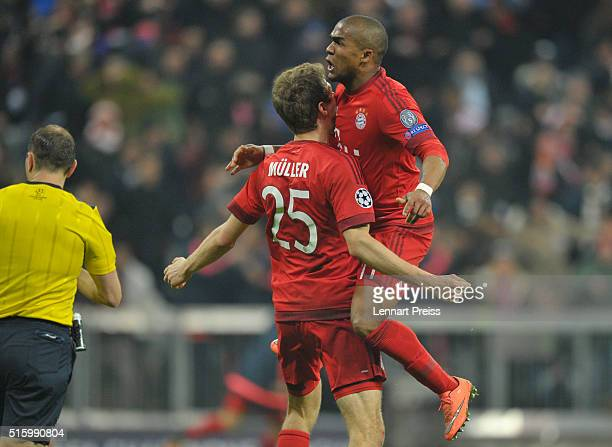 Thomas Mueller and Douglas Costa of Bayern Muenchen celebrate their team's second goal during the UEFA Champions League Round of 16 second leg match...