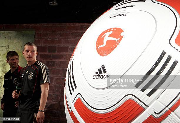 Thomas Mueller and Lukas Podolski of Germany are pictured during the presentation of the first official ball 'Torfabrik' for the german bundesliga...