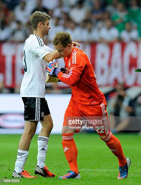 Thomas Mueller and Marc Andre ter Stegen pictured after a substitution during the international friendly match between Germany and Argentina at...