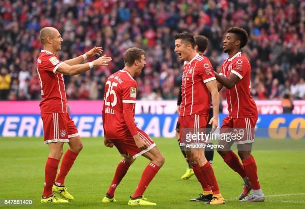 Thomas Mueller and Robert Lewandowski of Bayern Munich celebrate after scoring a goal during the Bundesliga soccer match between Bayern Munich and...