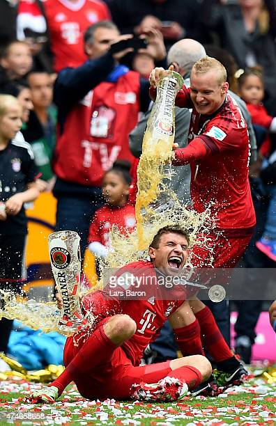 Thomas Mueller and Sebastian Rode of Bayern Muenchen celebrate after winning the league after the Bundesliga match between FC Bayern Muenchen and 1...