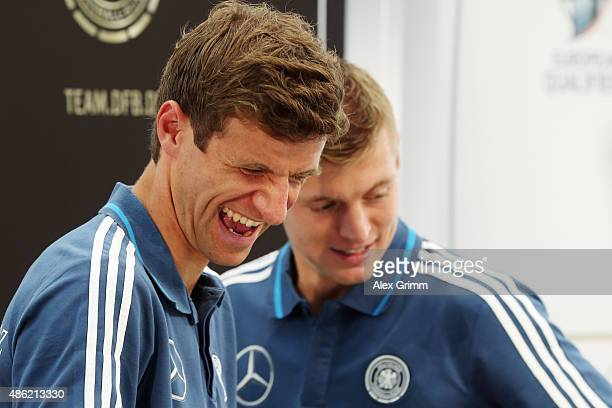 Thomas Mueller and Toni Kroos attend a Germany press conference at CommerzbankArena on September 2 2015 in Frankfurt am Main Germany