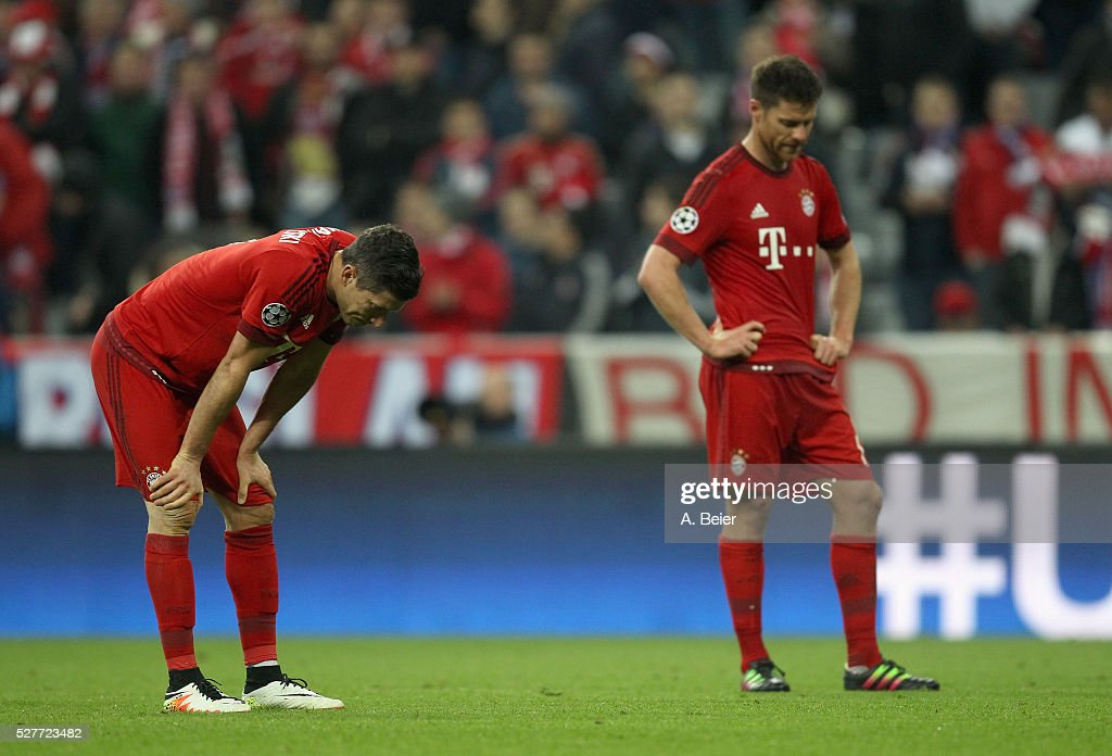 Thomas Mueller (L) and Xabi Alonso of Bayern Muenchen react after their team's loss of the Champions League semi final second leg match between FC Bayern Muenchen and Club Atletico de Madrid at Allianz Arena on May 3, 2016 in Munich, Germany.