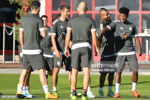 Thomas Mueller Arturo Vidal and David Alaba of FC Bayern Muenchen joke during a Bayern Muenchen training session ahead of the UEFA Champions League...