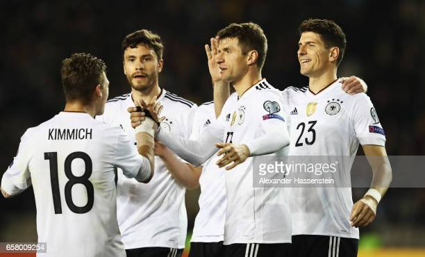 Thomas Mueller celebrates scoring the second goal with Joshua Kimmich Mario Gomez and Jonas Hector during the FIFA 2018 World Cup Qualifiying group C...