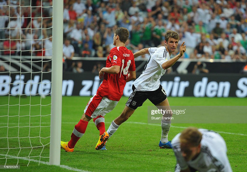Thomas Mueller celebrates scoring the third goal during the FIFA 2014 world cup qualifier match between Germany and Austria at the Allianz Arena on September 6, 2013 in Munich, Germany.