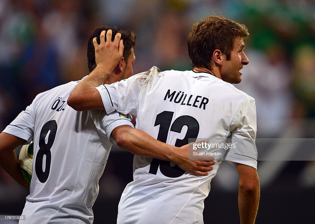 Thomas Mueller celebrates scoring the third goal with Mesut Oezil during the FIFA 2014 world cup qualifier match between Germany and Austria at the Allianz Arena on September 6, 2013 in Munich, Germany.