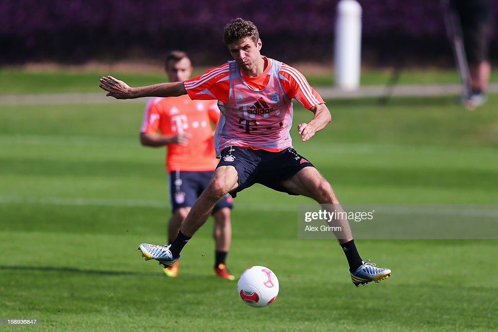 <a gi-track='captionPersonalityLinkClicked' href=/galleries/search?phrase=Thomas+Mueller&family=editorial&specificpeople=5842906 ng-click='$event.stopPropagation()'>Thomas Mueller</a> controles the ball during a Bayern Muenchen training session at the ASPIRE Academy for Sports Excellence on January 4, 2013 in Doha, Qatar.