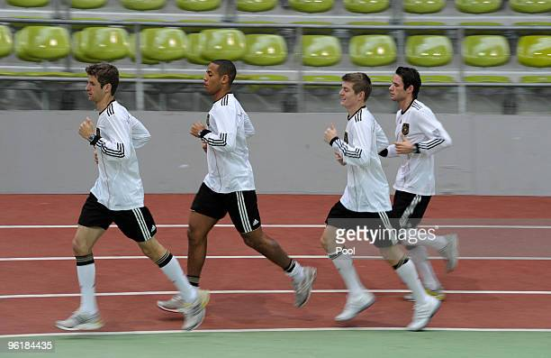 Thomas Mueller Dennis Aogo Toni Kroos and Christian Traesch of the German national football team are seen during a fitness test at the Glaspalast on...