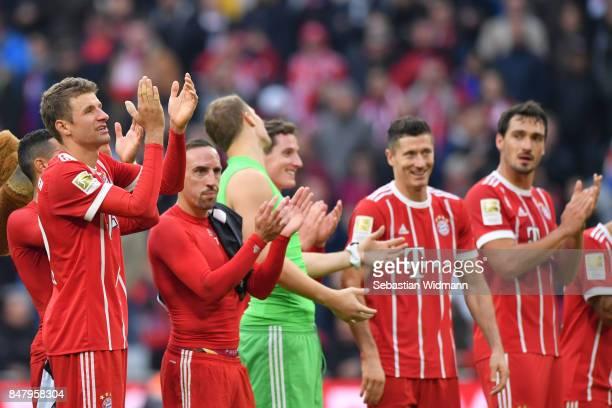Thomas Mueller Franck Ribery goalkeeper Manuel Neuer Robert Lewandowski Mats Hummels the Bundesliga celebrate with their fans after the match between...