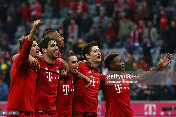 Thomas Mueller Javier Martinez Philipp Lahm Jerome Boateng Robert Lewandowski and David Alaba of Muenchen celebrate victory after winning the...