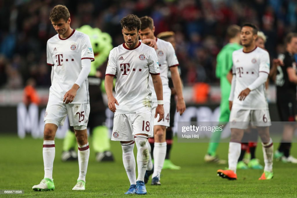 Thomas Mueller (L-R), Juan Bernat and Thiago Alcantara do Nascimento of Bayern react after the Bundesliga match between Bayer 04 Leverkusen and Bayern Muenchen at BayArena on April 15, 2017 in Leverkusen, Germany.