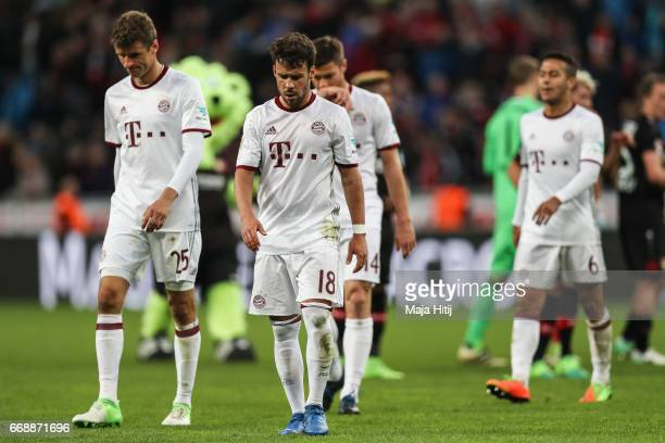 Thomas Mueller Juan Bernat and Thiago Alcantara do Nascimento of Bayern react after the Bundesliga match between Bayer 04 Leverkusen and Bayern...