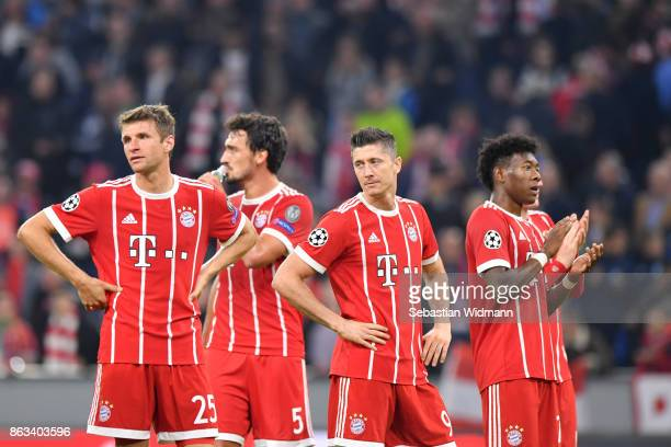 Thomas Mueller Mats Hummels Robert Lewandowski and David Alaba of FC Bayern Muenchen stand together after the UEFA Champions League group B match...