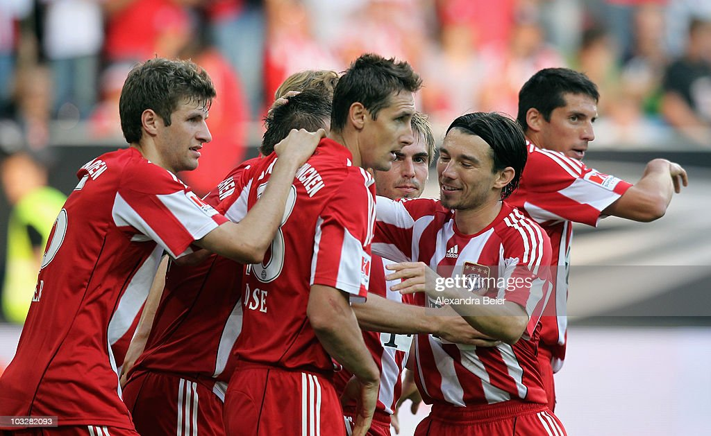 Thomas Mueller Miroslav Klose Philipp Lahm Danijel Pranjic and Jose Ernesto Sosa of Muenchen celebrate their team's second goal during the Supercup...