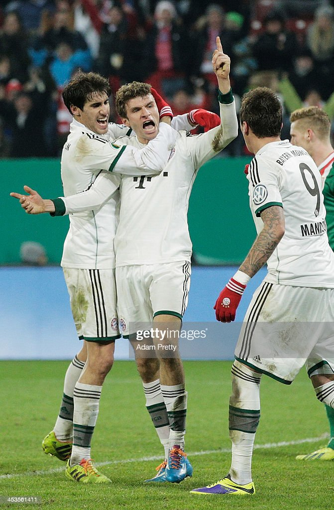 Thomas Mueller of Bayern celebrates scoring a goal during the FC Augsburg v Bayern Muenchen DFB Cup match at SGL Arena on December 4, 2013 in Augsburg, Germany.
