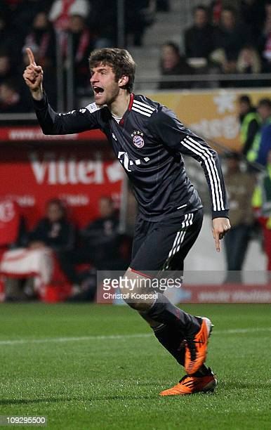 Thomas Mueller of Bayern celebrates the second goal during the Bundesliga match between FSV Mainz 05 and FC Bayern Muenchen at Bruchweg Stadium on...