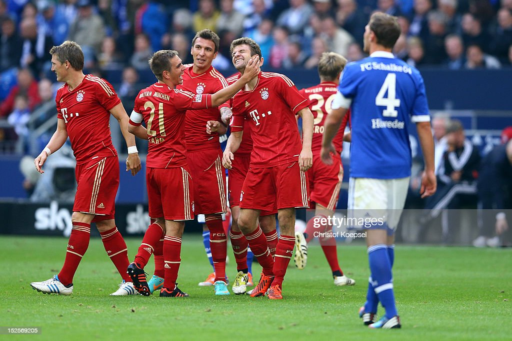 Thomas Mueller of Bayern (2nd R) celebrates the second goal with <a gi-track='captionPersonalityLinkClicked' href=/galleries/search?phrase=Philipp+Lahm&family=editorial&specificpeople=483746 ng-click='$event.stopPropagation()'>Philipp Lahm</a> (2nd L) and <a gi-track='captionPersonalityLinkClicked' href=/galleries/search?phrase=Mario+Mandzukic&family=editorial&specificpeople=4476149 ng-click='$event.stopPropagation()'>Mario Mandzukic</a> (3rd L) of Bayern during the Bundesliga match between FC Schalke 04 and FC Bayern Muenchen at Veltins-Arena on September 22, 2012 in Gelsenkirchen, Germany.