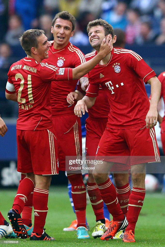 Thomas Mueller of Bayern celebrates the second goal with <a gi-track='captionPersonalityLinkClicked' href=/galleries/search?phrase=Philipp+Lahm&family=editorial&specificpeople=483746 ng-click='$event.stopPropagation()'>Philipp Lahm</a> (L) and <a gi-track='captionPersonalityLinkClicked' href=/galleries/search?phrase=Mario+Mandzukic&family=editorial&specificpeople=4476149 ng-click='$event.stopPropagation()'>Mario Mandzukic</a> (C) during the Bundesliga match between FC Schalke 04 and FC Bayern Muenchen at Veltins-Arena on September 22, 2012 in Gelsenkirchen, Germany.