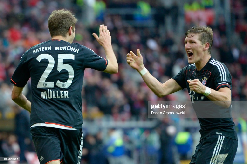 <a gi-track='captionPersonalityLinkClicked' href=/galleries/search?phrase=Thomas+Mueller&family=editorial&specificpeople=5842906 ng-click='$event.stopPropagation()'>Thomas Mueller</a> of Bayern celebrates with teammate <a gi-track='captionPersonalityLinkClicked' href=/galleries/search?phrase=Bastian+Schweinsteiger&family=editorial&specificpeople=203122 ng-click='$event.stopPropagation()'>Bastian Schweinsteiger</a> after scoring his team's first goal during the Bundesliga match between 1. FSV Mainz 05 and FC Bayern Muenchen at Coface Arena on February 2, 2013 in Mainz, Germany.