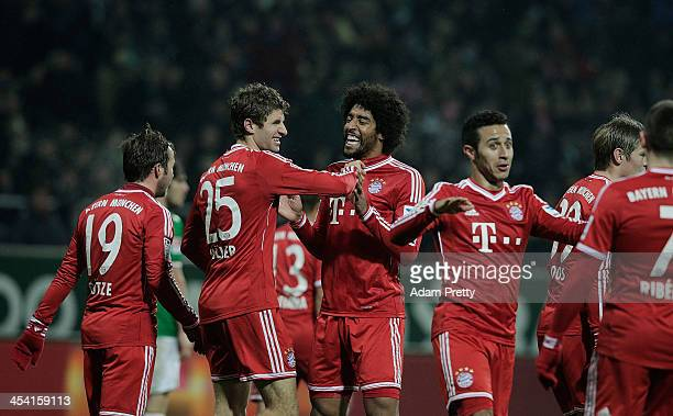Thomas Mueller of Bayern is congratulated by Dante after scoring a goal during the Bundesliga match between Werder Bremen and FC Bayern Muenchen at...