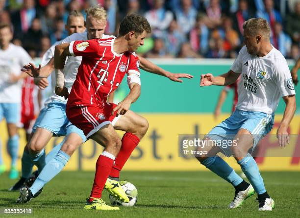 Thomas Mueller of Bayern Muenchen and Fabio Leutenecker of Chemnitz battle for the ball during the DFB Cup first round match between Chemnitzer FC...