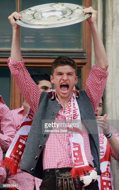 Thomas Mueller of Bayern Muenchen and his teammates celebrate the German championship title on the balcony of the town hall on May 9 2010 in Munich...