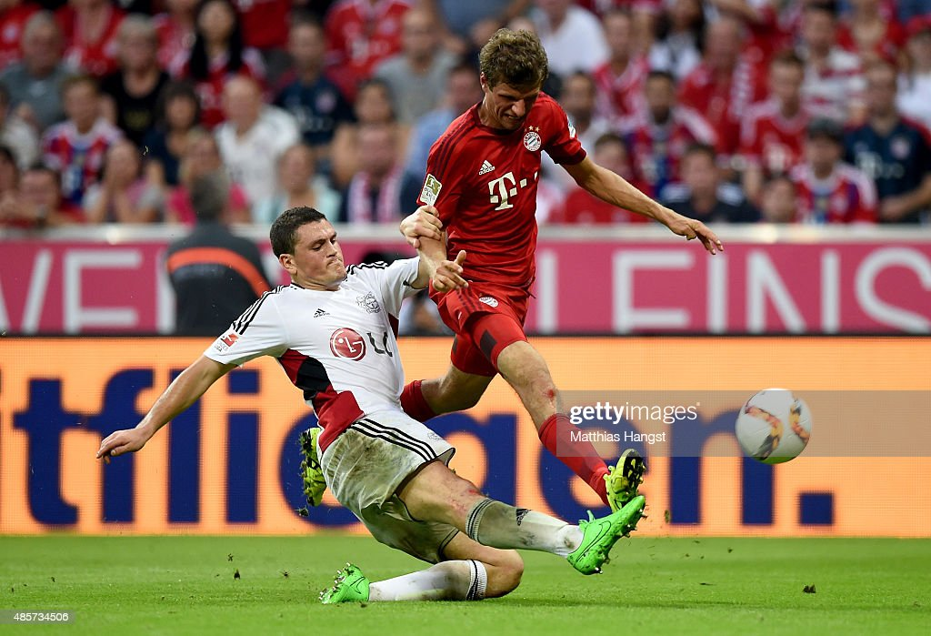 <a gi-track='captionPersonalityLinkClicked' href=/galleries/search?phrase=Thomas+Mueller&family=editorial&specificpeople=5842906 ng-click='$event.stopPropagation()'>Thomas Mueller</a> (R) of Bayern Muenchen and <a gi-track='captionPersonalityLinkClicked' href=/galleries/search?phrase=Kyriakos+Papadopoulos&family=editorial&specificpeople=5446261 ng-click='$event.stopPropagation()'>Kyriakos Papadopoulos</a> of Leverkusen head for the ball during the Bundesliga match between FC Bayern Muenchen and Bayer Leverkusen at Allianz Arena on August 29, 2015 in Munich, Germany.