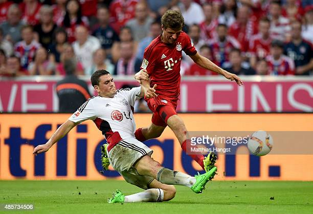 Thomas Mueller of Bayern Muenchen and Kyriakos Papadopoulos of Leverkusen head for the ball during the Bundesliga match between FC Bayern Muenchen...