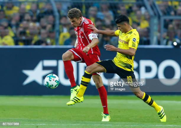Thomas Mueller of Bayern Muenchen and Mahmoud Dahoud of Dortmund battle for the ball during the DFL Supercup 2017 match between Borussia Dortmund and...