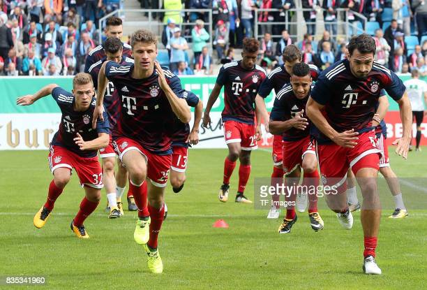 Thomas Mueller of Bayern Muenchen and Mats Hummels of Bayern Muenchen warm up during the DFB Cup first round match between Chemnitzer FC and FC...