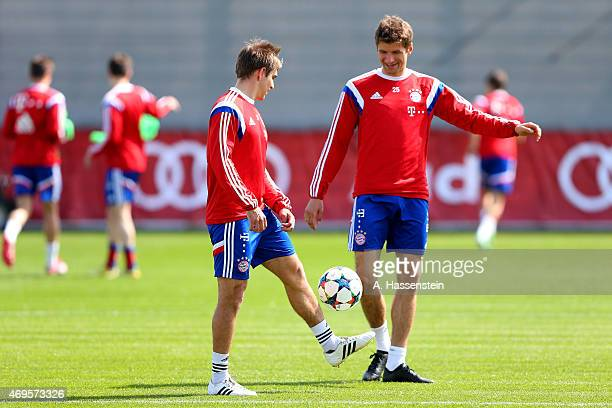Thomas Mueller of Bayern Muenchen and team captain Philipp Lahm play with the ball during a training session at Bayern Muenchen's trainings ground...