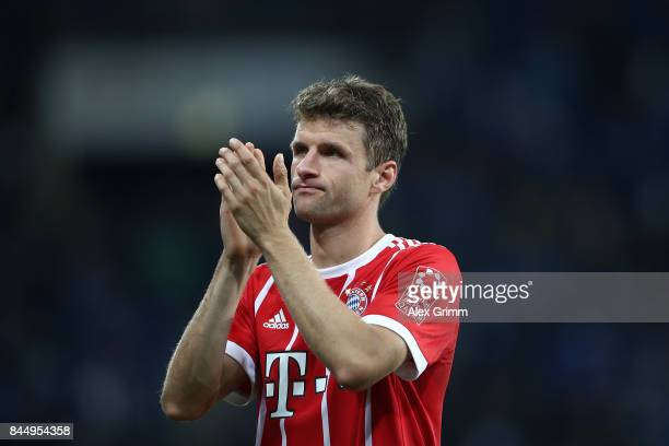 Thomas Mueller of Bayern Muenchen applauds their supporters as he looks dejected after the Bundesliga match between TSG 1899 Hoffenheim and FC Bayern...