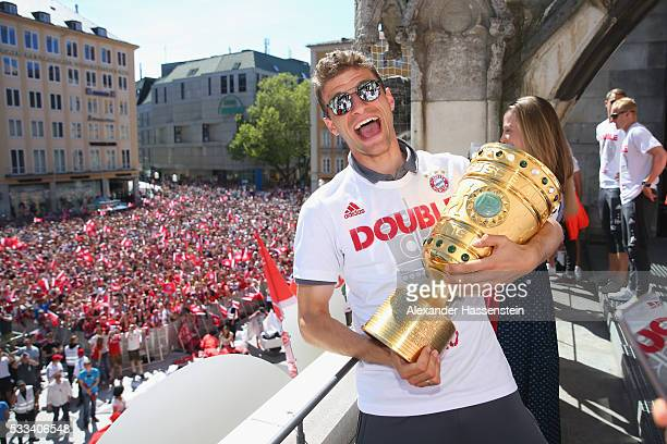 Thomas Mueller of Bayern Muenchen celebrate winning the DFB German Cup title on the town hall balcony at Marienplatz on May 22 2016 in Munich Germany