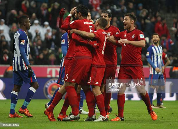 Thomas Mueller of Bayern Muenchen celebrates his first goal together with teammates during the Bundesliga match between FC Bayern Muenchen and Hertha...