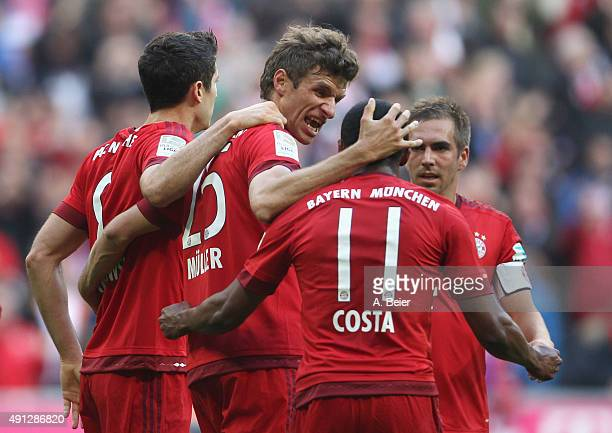 Thomas Mueller of Bayern Muenchen celebrates his first goal with teammates Robert Lewandowski Douglas Costa and Philipp Lahm celebrate the first goal...