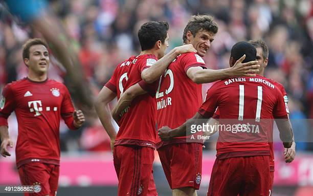 Thomas Mueller of Bayern Muenchen celebrates his first goal with teammates Mario Goetze Robert Lewandowski Douglas Costa and Philipp Lahm celebrate...