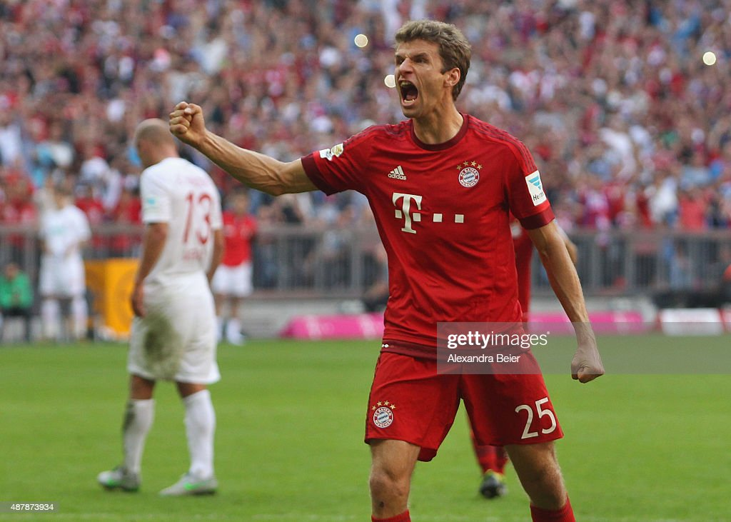 <a gi-track='captionPersonalityLinkClicked' href=/galleries/search?phrase=Thomas+Mueller&family=editorial&specificpeople=5842906 ng-click='$event.stopPropagation()'>Thomas Mueller</a> of Bayern Muenchen celebrates his penalty goal during the Bundesliga match between FC Bayern Muenchen and FC Augsburg at Allianz Arena on September 12, 2015 in Munich, Germany.