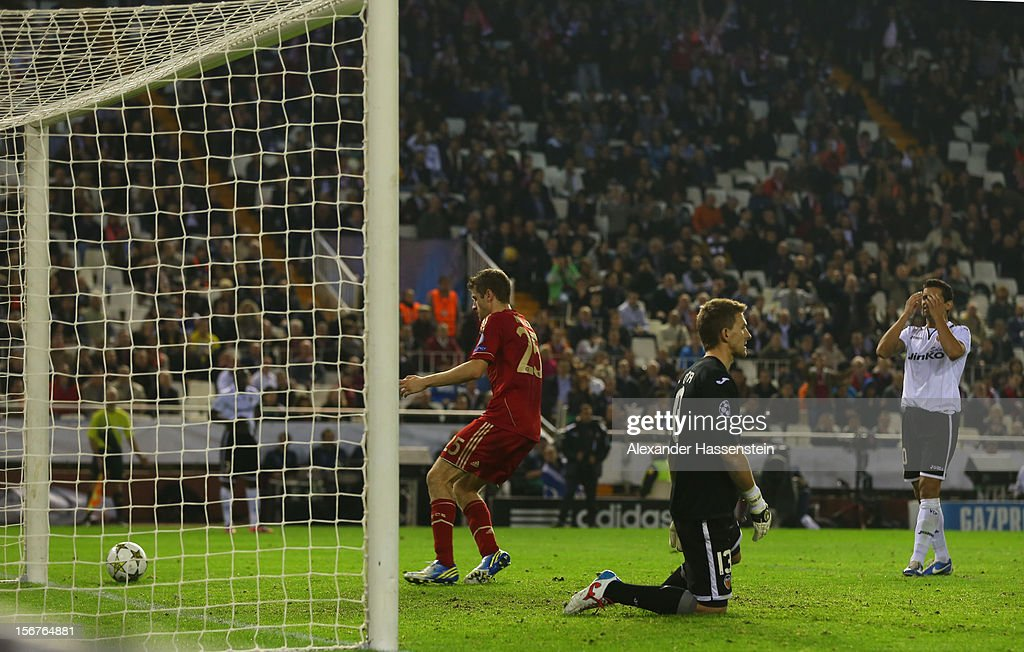 Thomas Mueller (L) of Bayern Muenchen celebrates scoring his first team goal during the UEFA Champions League group F match between Valencia FC and FC Bayern Muenchen at Estadio Mestalla on November 20, 2012 in Valencia, Spain.