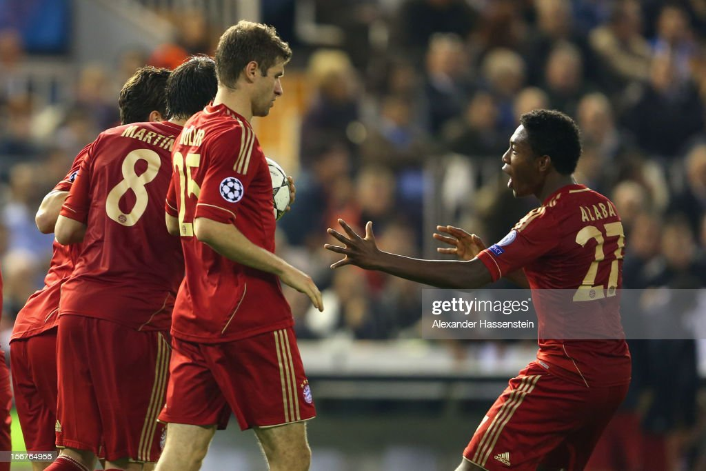 Thomas Mueller (C) of Bayern Muenchen celebrates scoring his first team goal with his team mate David Alaba (R) during the UEFA Champions League group F match between Valencia FC and FC Bayern Muenchen at Estadio Mestalla on November 20, 2012 in Valencia, Spain.