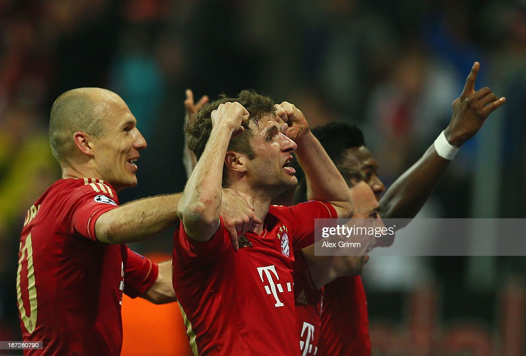 <a gi-track='captionPersonalityLinkClicked' href=/galleries/search?phrase=Thomas+Mueller&family=editorial&specificpeople=5842906 ng-click='$event.stopPropagation()'>Thomas Mueller</a> of Bayern Muenchen celebrates scoring the fourth goal with <a gi-track='captionPersonalityLinkClicked' href=/galleries/search?phrase=Arjen+Robben&family=editorial&specificpeople=194740 ng-click='$event.stopPropagation()'>Arjen Robben</a> (L) during the UEFA Champions League Semi Final First Leg match between FC Bayern Muenchen and Barcelona at Allianz Arena on April 23, 2013 in Munich, Germany.