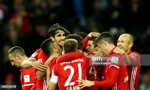 Thomas Mueller of Bayern Muenchen celebrates the first goal with his team mates during the Bundesliga match between Borussia Moenchengladbach and...