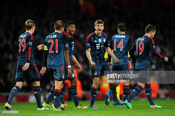 Thomas Mueller of Bayern Muenchen celebrates with his team mates after scoring the second goal during the UEFA Champions League Round of 16 first leg...