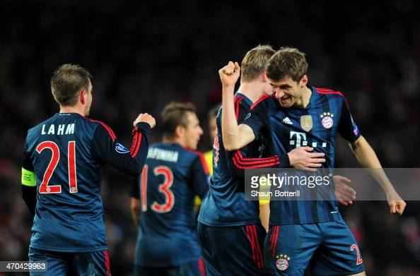 Thomas Mueller of Bayern Muenchen celebrates with Philipp Lahm of Bayern Muenchen after scoring the second goal during the UEFA Champions League...