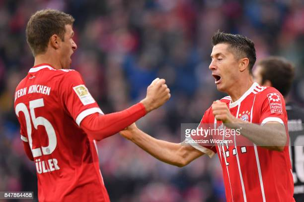 Thomas Mueller of Bayern Muenchen celebrates with Robert Lewandowski of Bayern Muenchen after Lewandowski scored his teams third goal to make it 30...
